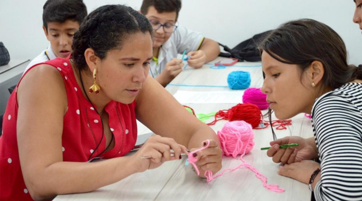 Ana Maria Porras with student crocheting