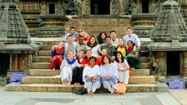 Students and scholars sitting on steps in India in summer 2018