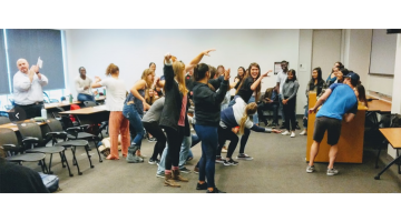 students acting in improv exercise