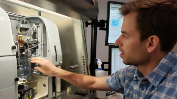 Adam Wojno, director of the Flow Cytometry Facility, sets up samples in a cell sorter.