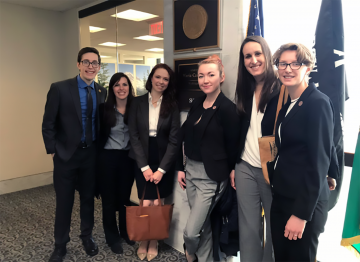 Joseph Long with colleagues in washington dc office