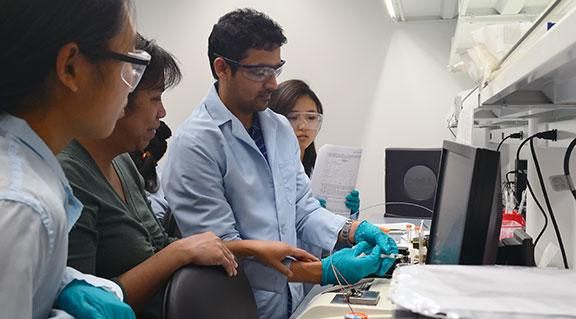 undergraduate students working in a lab
