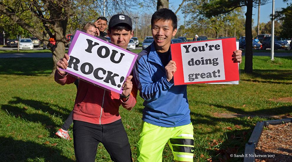 graduate students cheer runners