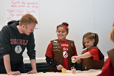 graduate student working with girl scouts
